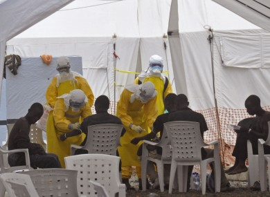 Health workers, attend to patients with Ebola at a clinic in Monrovia, Liberia.