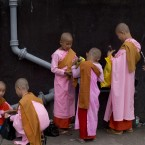 Novice Buddhist nuns pack their possessions after begging for alms in streets of Yangon, Myanmar.<span class=