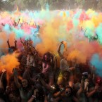 Revelers throw coloured powder in the air during the Holi Festival of Colours, in Lisbon.<span class=