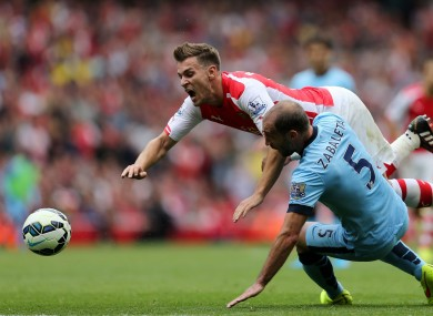 Arsenal's Aaron Ramsey is tackled by manchester City's Pablo Zabaleta.