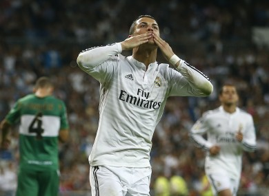 Cristiano Ronaldo celebrates scoring his third goal against Elche earlier tonight. He's now scored seven times in the past four days.