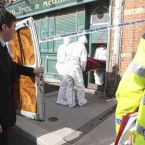 Forensic garda officers remove a body of a suspected man who was found at the North Wall Quay.