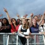 Fans watch lead singer Damon Albarn of BLUR perform.