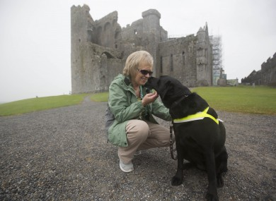 Olive Cummins with her dog Eve at the Rock of Cashel.