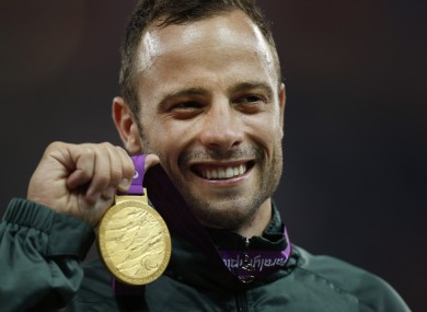 Oscar Pistorius with his gold medal after winning during the 2012 London Paralympics.