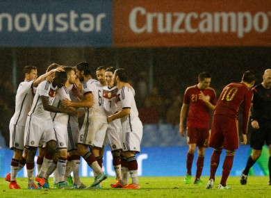 Germany's Toni Kroos celebrates scoring his side's first goal of the game with teammates.