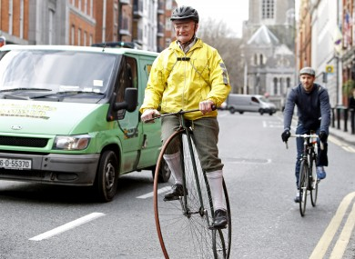 Pete Matthews, from Dublin, rides his penny farthing in the city centre.