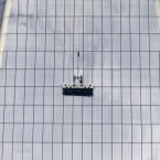 Workers, using a scaffold, replace a window at 1 World Trade in New York, the day after two window washers were rescued from a dangling scaffold by firefighters who cut through the pane to reach them. (AP Photo/Kathy Willens)<span class=