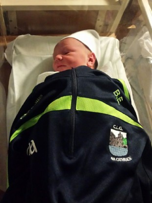 Baby Dylan in his dad's Cahir top.