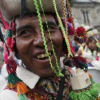 Indians play traditional instruments in front of Bolivia's presidential palace before the swearing-in ceremony of Bolivia's President Evo Morales in La Paz, Bolivia, Thursday, Jan. 22, 2015. Morales begins a third term, that will make him the Andean nation's longest-serving leader, riding high on a wave of unprecedented growth and stability. <span class=