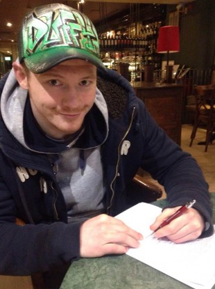 Duffy signing his UFC contract today in London.