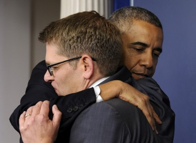 US President Barack Obama hugs his press secretary, Jay Carney