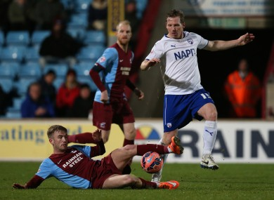 Scunthorpe United's Paddy Madden (left) and Chesterfield's Ritchie Humphreys in action