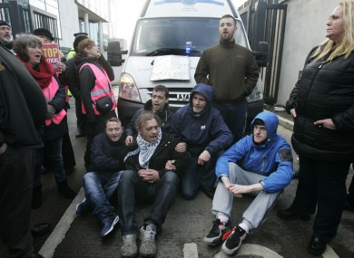Group of anti water charge supporters block a prison van leaving the courts yesterday.