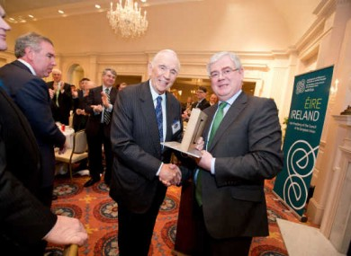 Eamon Gilmore presenting Don Keough, former President of Coca-Cola, the Presidential Distinguished Service Award for the Irish Abroad, in 2013