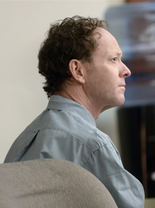 Johnny Brickman Wall listens to testimony during his trial.