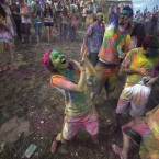 Revelers covered in colored corn starched celebrate during the 2015 Festival of Colors, Holi Celebration at the Krishna Temple in Spanish Fork, Utah. (AP Photo/Rick Bowmer)<span class=