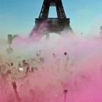 People take part in the Color Run near the Eiffel Tower, in Paris, France. The Color Run is a 5 kilometer (3.1 mile) running event where participants are covered in bright colored powder at each check station and is less about speed and more about enjoying a day with friends and family. <span class=