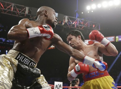 Floyd Mayweather and Manny Pacquiao in action on Saturday.