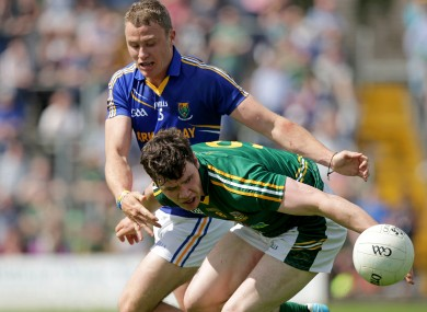 Meath's Harry Rooney is challenged by Dean Healy of Wicklow.