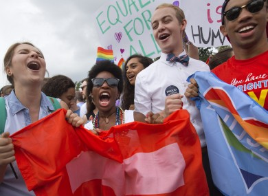 Hundreds celebrated outside the US Supreme Court in Washington on Friday after it ruled that same-sex couples could marry nationwide.