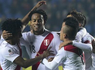 Peru forward Andre Carrillo celebrates with teammates.