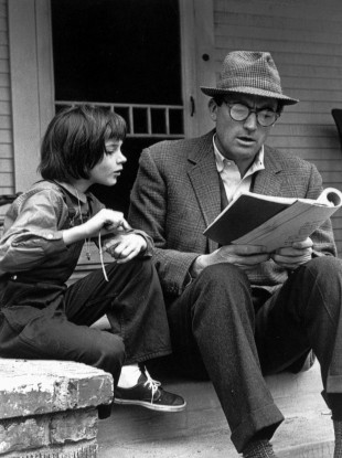 Actor Gregory Peck and 9-year-old Mary Badham study their lines during a break on the set of the film