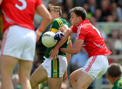 James O'Donoghue and Mark Collins challenge for the ball during the drawn Munster final.