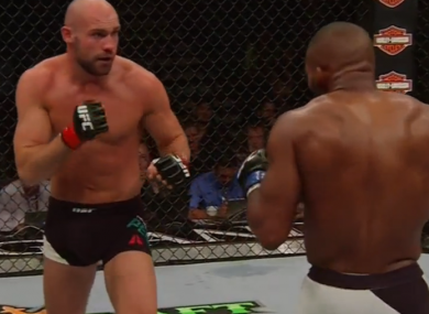 Cathal Pendred in action against John Howard.
