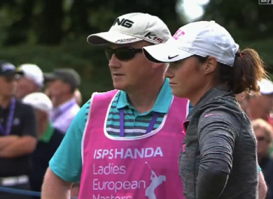 Maguire with her father on the 18th green.