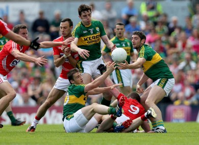 Cork and Kerry players battle for possession in the drawn game.