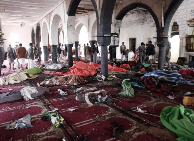 Bodies of people killed in a suicide attack during the noon prayer are covered in blankets in a mosque in Sanaa
