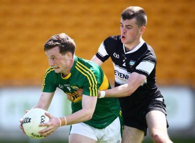 Kerry's Stephen O'Sullivan and Brian Mahon of Sligo battle for possession.