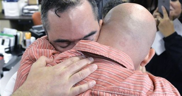 Joyous scenes - and insults - as gay couples get marriage licences