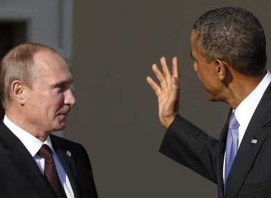 Obama gestures as he speaks to Russian President Vladimir Putin during arrivals for the G-20 Summit in St Petersburg, Russia in 2013.