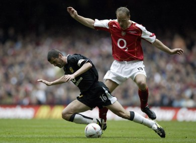 Keane challenges Arsenal's Denis Bergkamp in the 2005 FA Cup final at the Millennium Stadium.