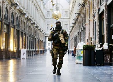 A Belgium army soldier walks through the Galeries Royal Saint-Hubert in Brussels last month during a terror alert.