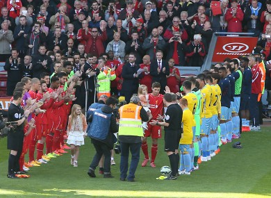 Liverpool's Steven Gerrard walks out to a guard of honour before his final game at Anfield.
