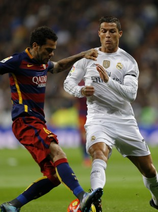 Alves and Barcelona ran out 4-0 winners in the first Clasico of the season.