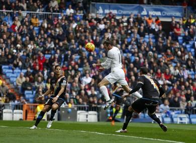 Real Madrid's Gareth Bale heads the ball to score past Rayo Vallecano's Antonio Amaya.