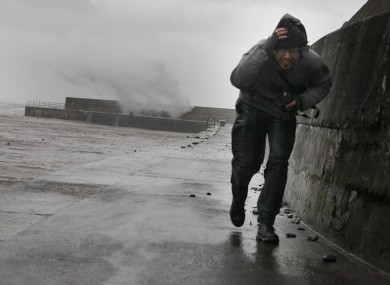 File photo: Stefano Fedele from Italy runs from waves created by Storm Frank winds on Bray Harbour earlier this month.