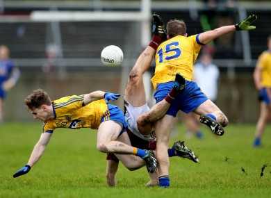 Roscommon's Cian Connolly and Cathal McHugh collide with Galway's Eoghan Kerin.