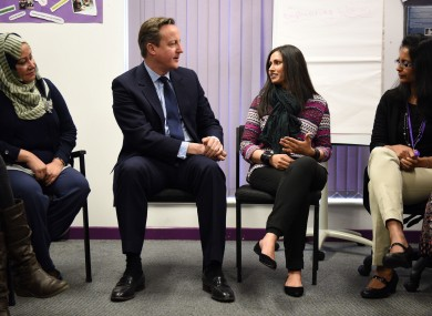 David Cameron meets women attending an English language class during a visit to the Shantona Women's Centre in Leeds.