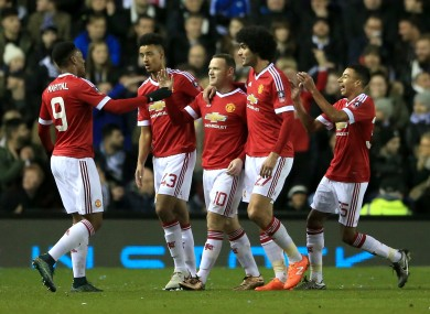 The United players celebrate with Rooney.