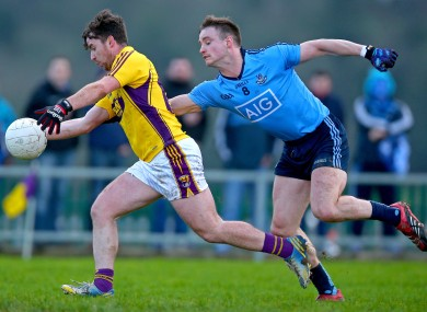 Ben Brosnan of Wexford and Dublin's Eoin Culligan in action in Enniscorthy.