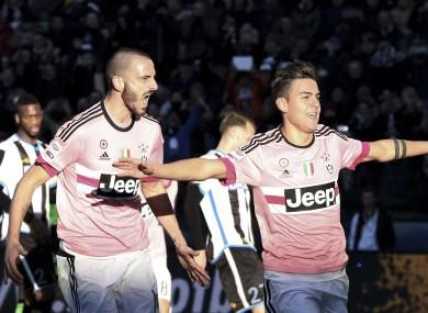 Juventus' Paulo Dybala, right, celebrates after scoring.