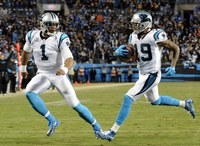 Ted Ginn Jr scores the game's first touchdown as Cam Newton watches on.