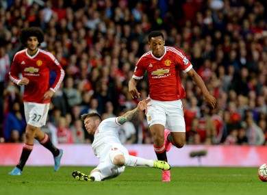 Liverpool's Alberto Moreno (left) challenges Manchester United's Anthony Martial during the last meeting between the sides.