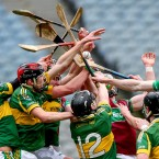 Eoghan Rua and Glemore players battle for the ball<span class=