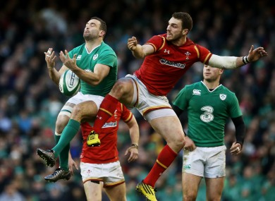 Ireland's Dave Kearney (left) and Wales' George North compete for a high ball.